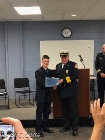 FF John Ost-Prisco receiving his certificate