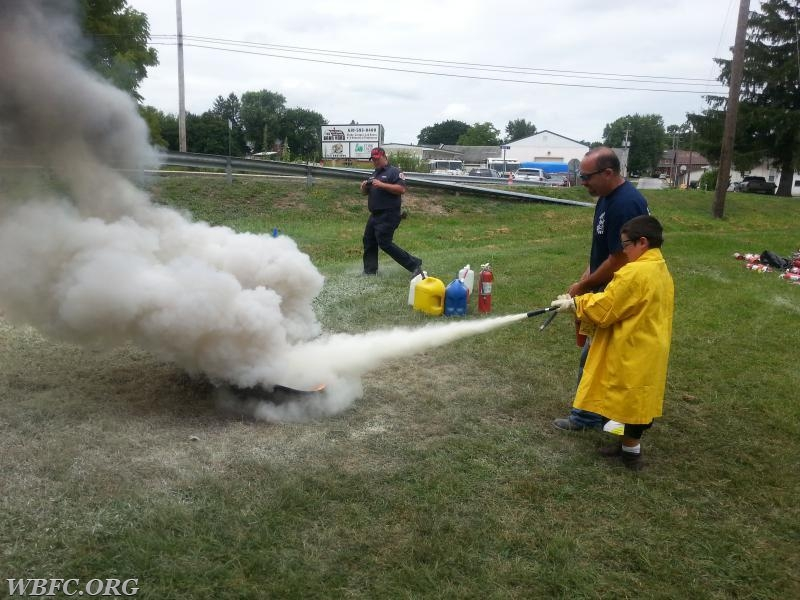 A picture from the past, at Kids Camp with FF DiSalvo, giving instructions on the use of a portable fire extinguisher.