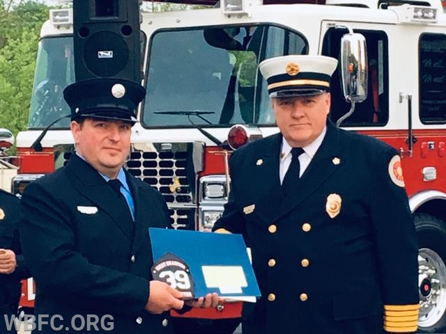 Patrick (L) receiving his certificate and his Fire Fighter Frontice from Chief Law