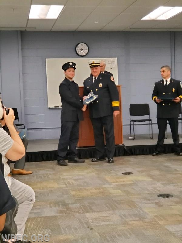 Fire Fighter Anthony Trento receiving his certificate