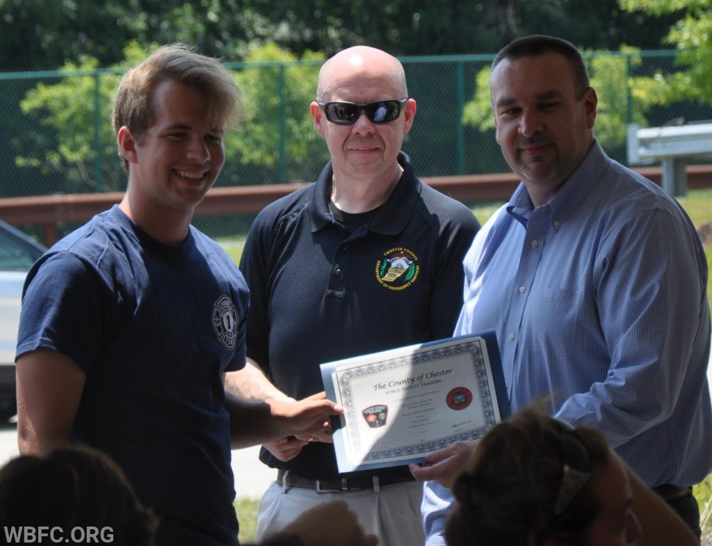 Brian Moore accepting his certificate