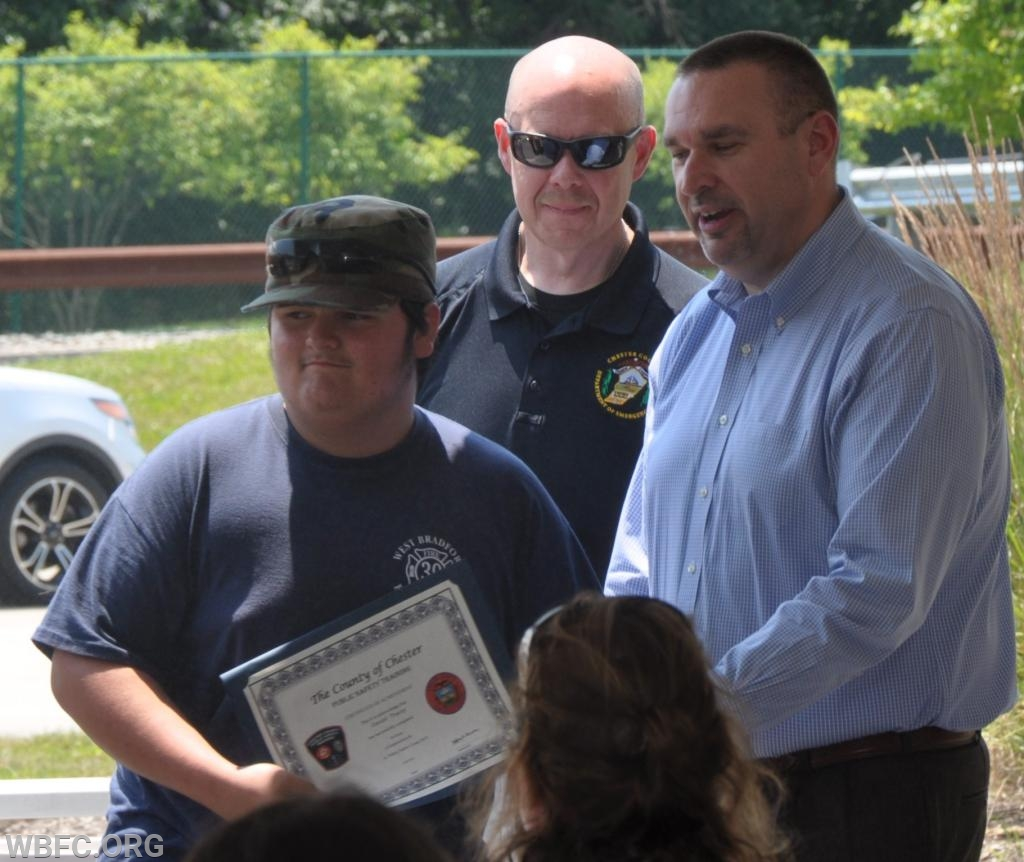 Daniel Tracey accepting his certificate