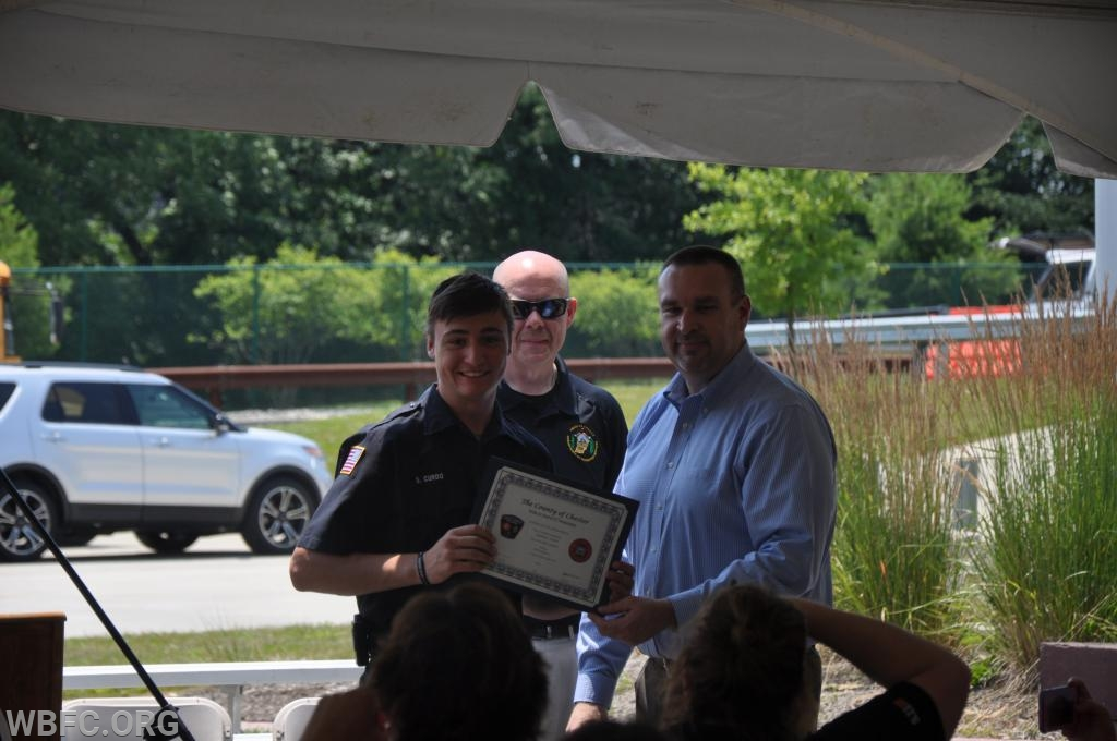 Sam Curdo accepting his certificate