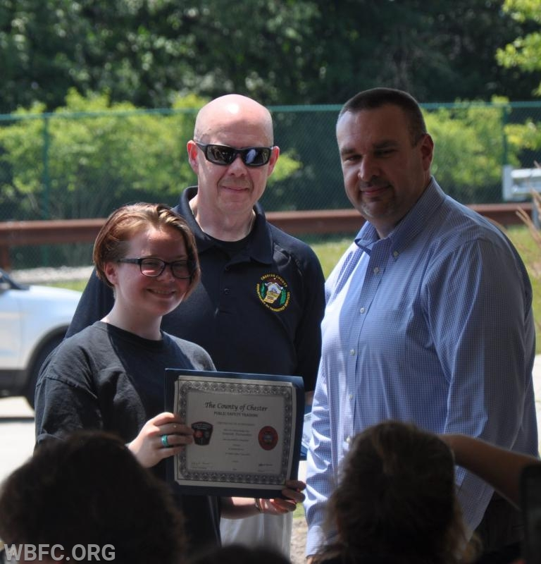Hannah Fairweather accepting her certificate